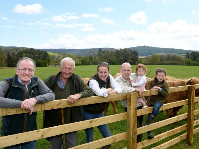 James and Julie McDonald with their fathers and two of their three children