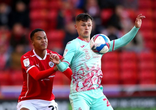 Wembley aim: Barnsley's Toby Sibbick, up against Swansea City's Liam Cullen.