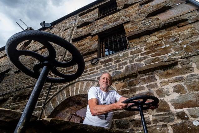 Neil McNair has restored the waterwheel at Low Mill Guest House, Bainbridge, Leyburn