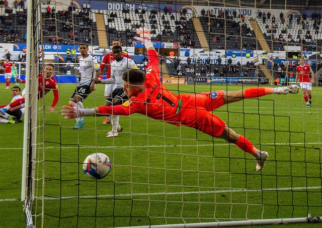 Get in: Cauley Woodrow beats Freddy Woodman to give Barnsley hope. Pictures: Bruce Rollinson