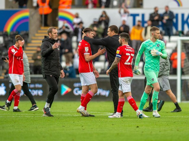 Barnsley FC head coach Valerien Ismael consoles his players at the final whistle at Swansea. Picture: Bruce Rollinson.
