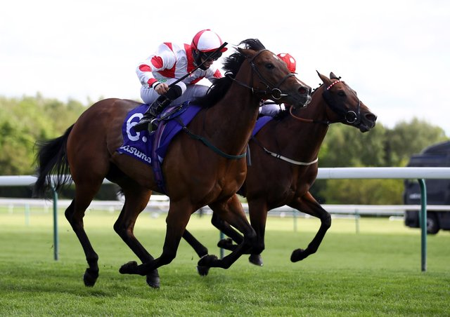 Liberty Beach ridden by jockey Jason Hart (near side) on their way to winning the Casumo Best Odds Guaranteed Temple Stakes at Haydock Park racecourse.