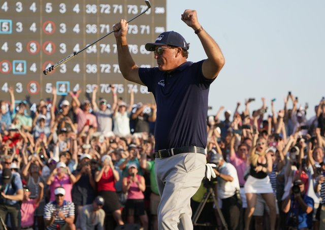 Phil Mickelson celebrates his historic win in golf's US PGA Champiomnships.