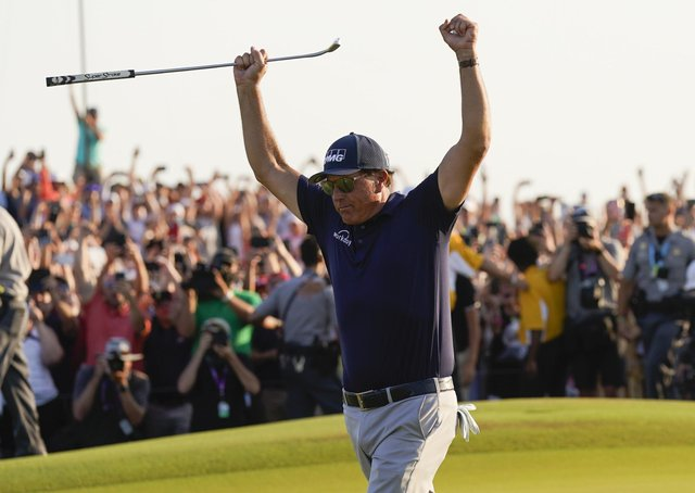 Done it: Phil Mickelson celebrates after the final round.