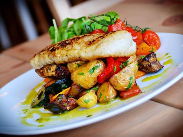 Kieran serves up dishes like roast cod loin with Mediterranean veg and chorizo. (Dave Lee).