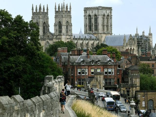 Visitors take a walk along York's city walls