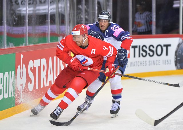CAPTAIN FANTASTIC: Jonathan Phillips battles for the puck against Russia in Riga. Picture: Dean Woolley.