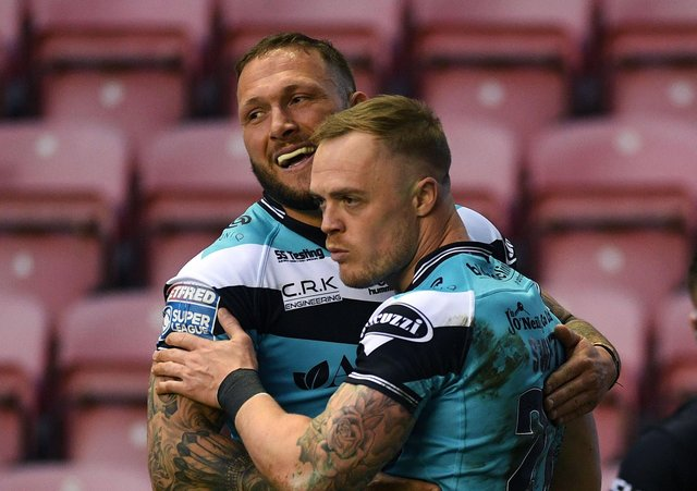 Hull's Adam Swift celebrates scoring his side's first try against Wigan with Josh Griffin.  Picture: Jonathan Gawthorpe