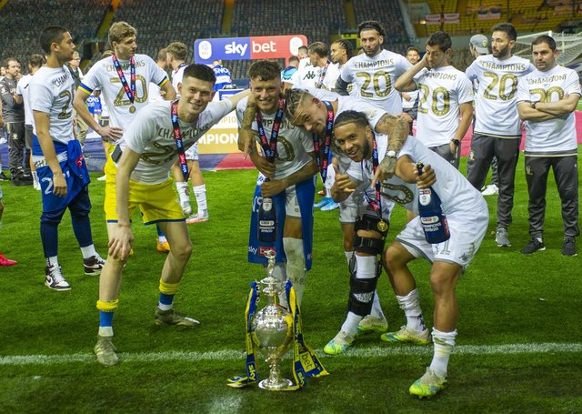 Leeds United's  Illan Meslier, Ben White, Kalvin Phillips and Tyler Roberts with the Championship trophy at Elland Road in 2020. Picture Tony Johnson