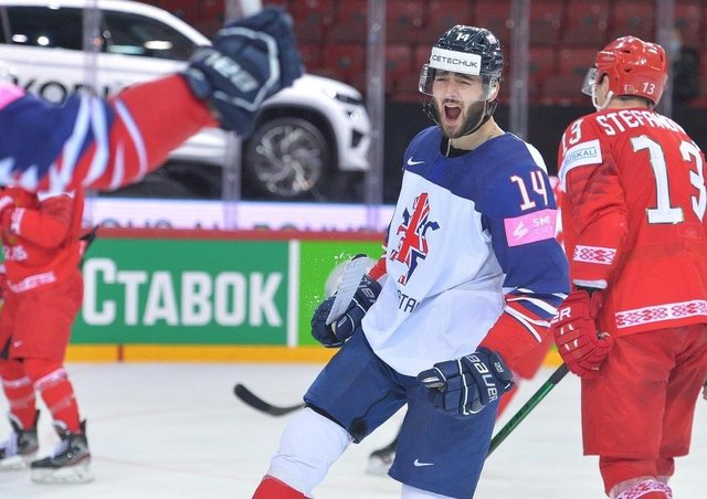 DOUBLE TROUBLE: Liam Kirk celebrates his second goal against Belarus at the World Championships in Riga. Picture: Dean Woolley.