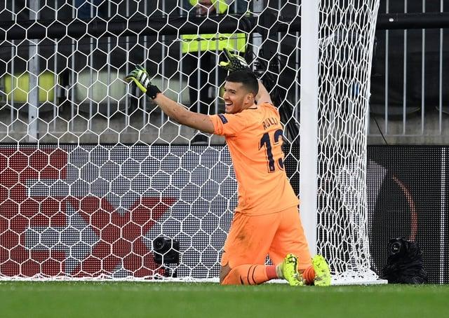 Villarreal's Geronimo Rulli celebrates saving Manchester United goalkeeper David de Gea's penalty (Picture: PA)