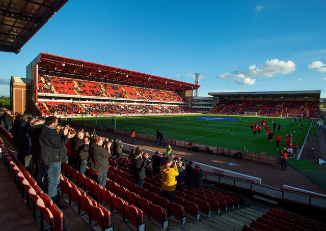 Well done: Fans back at Oakwel forBarnsley FC v Swansea City.   Picture: Bruce Rollinson