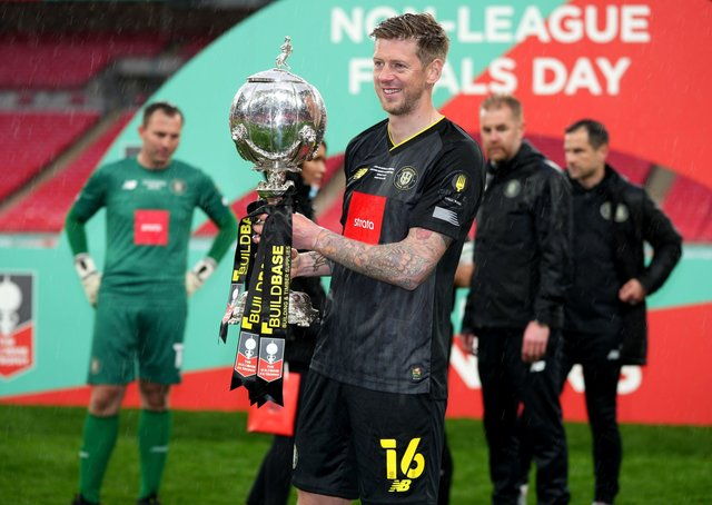 Signing off: Harrogate Town's Jon Stead celebrates with the FA Trophy at Wembley Stadium.