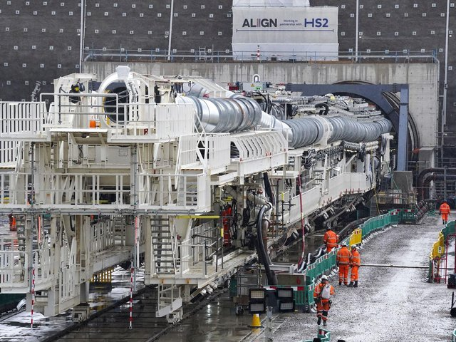 Florence - the largest ever tunnel boring machine used on a UK rail project - is unveiled at the HS2 site in West Hyde near Rickmansworth in Hertfordshire. Picture date: Thursday May 13, 2021. PA Photo. Named after nursing pioneer Florence Nightingale, The 558ft (170m) long contraption will dig a 10-mile tunnel under the Chiltern Hills, starting from a site in Buckinghamshire near the M25 motorway. See PA story RAIL HS2. Picture: Steve Parsons/PA Wire.