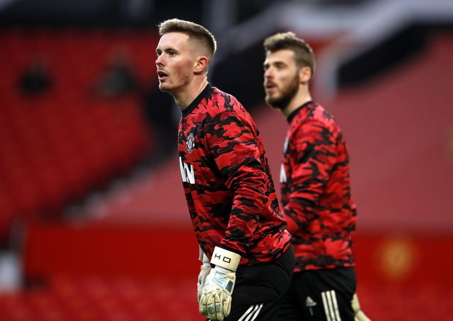 Out of the shadow: Manchester United goalkeepers Dean Henderson and David de Gea.