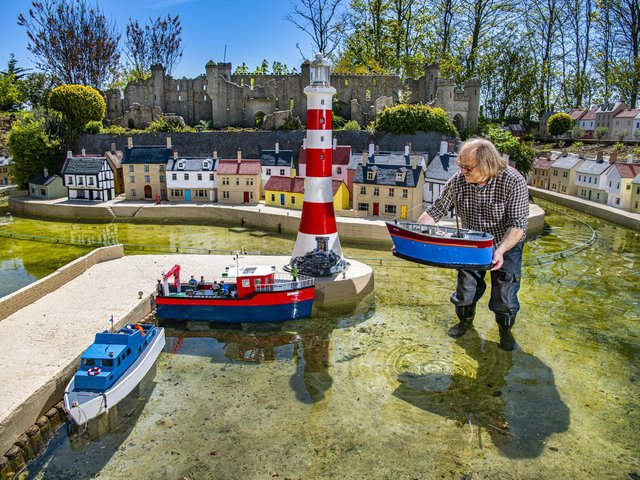 Owner Tim Whitehead positions the boats into the harbour ready for reopening to visitors this year after the easing of covid-19 restrictions at Bondville Model Village in Sewerby, Bridlington. Picture Tony Johnson