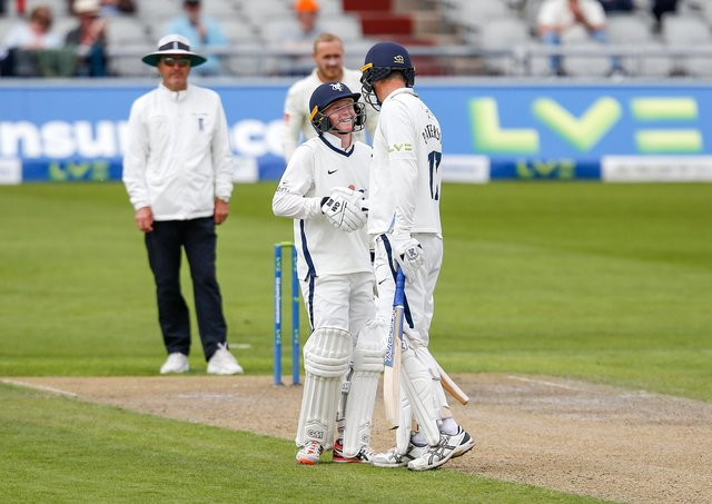 Teenager Harry Duke and captain Steve Patterson share a smile on a tough opening day for Yorkshire in the Roses match against Lancashire at Old Trafford. Picture: John Heald