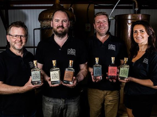 The team at York Gin with the company's new range of bottles