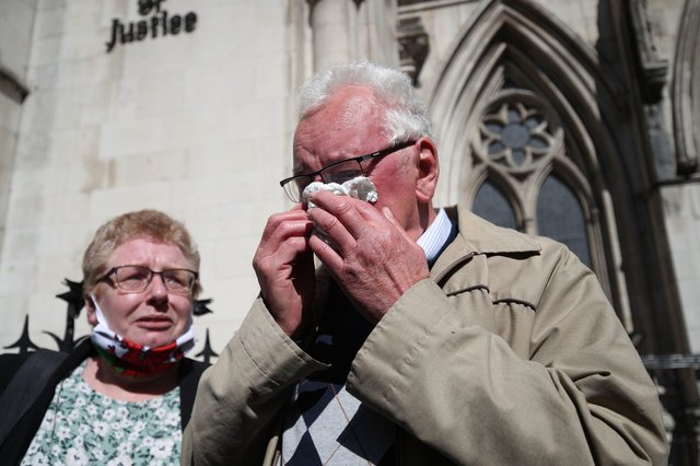 Former post office worker Noel Thomas, who was convicted of false accounting in 2006, celebrates with his daughter Sian outside the Royal Courts of Justice, London, after having his conviction overturned by the Court of Appeal.  Picture: Yui Mok/PA Wire