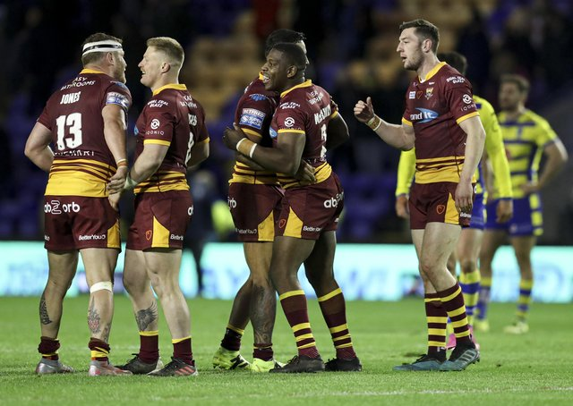 Togetherness: Huddersfield Giants have won three games on the trot and are aiming for four against Wakefield. Picture by Paul Currie/SWpix.com