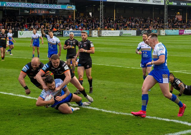 Tom Briscoe scores in Leeds Rhinos' 60-6 win over Castleford Tigers in Super League on Friday night.  Picture: Bruce Rollinson