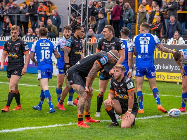 Castleford Tigers players are beaten again in the first half. (BRUCE ROLLINSON)