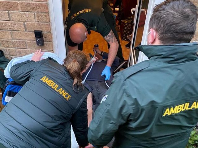 David, 71, was forced to lie with half of his body sticking out of the door because they were told by paramedics not to move him. (Credit: SWNS)