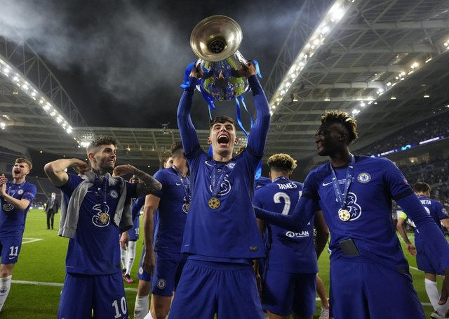 Chelsea's Kai Havertz celebrates with the trophy after winning the Champions League final soccer match between Manchester City and Chelsea at the Dragao Stadium in Porto. (AP Photo/Manu Fernandez, Pool)