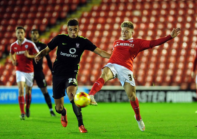 Ben Godfrey, left, playing for hometown York City in a Football League Trophy match with Barnsley in 2015 (Picture: Jonathan Gawthorpe)