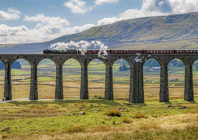 The British India Line loco crosses the Ribblehead Viaduct heading towards Settle from Carlisle. The Cumbrian Mountain Express is the first steam train of the year to run following lifting of coronavirus restrictions. Picture Tony Johnson.