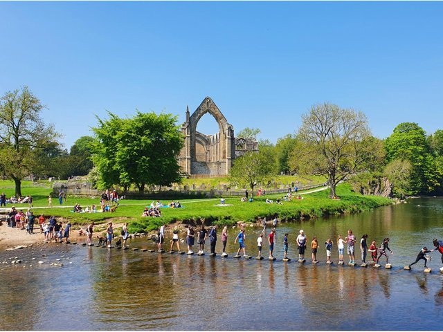People enjoy the sunshine at Bolton Abbey in Yorkshire, as Bank Holiday Monday could be the hottest day of the year so far - with temperatures predicted to hit 25C in parts of the UK.  PA WIRE