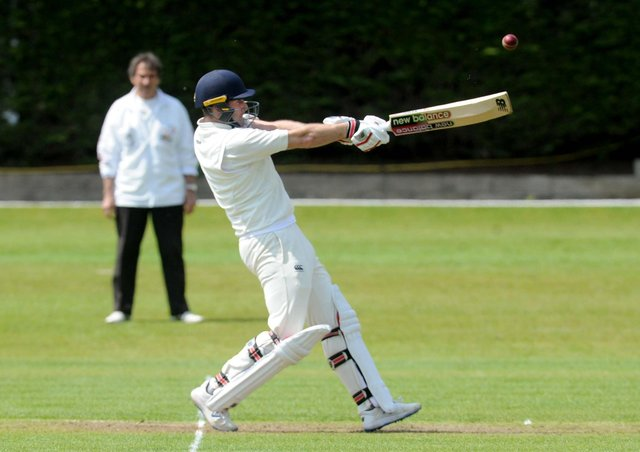 Big hit: Woodlands opener Sam Frankland hits a six in his innings of 42 during the Bradford League leaders 144-run victory over Wrenthorpe. Picture: Steve Riding