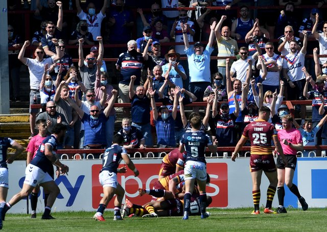 Wakefield's crowd cheers on Trinity as they score there fourth try. Pictures: Simon Hulme