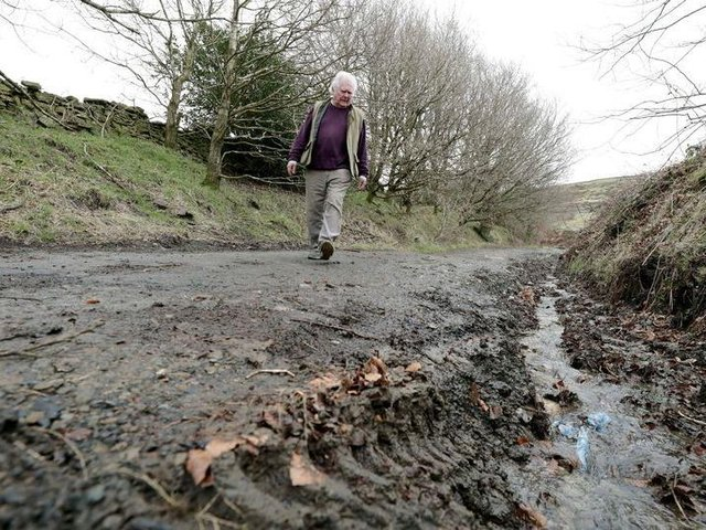 Holme Valley South councillor Donald Firth inspects damage to a green lane route used by bikers and 4×4 drivers. (Image: Andy Catchpool)