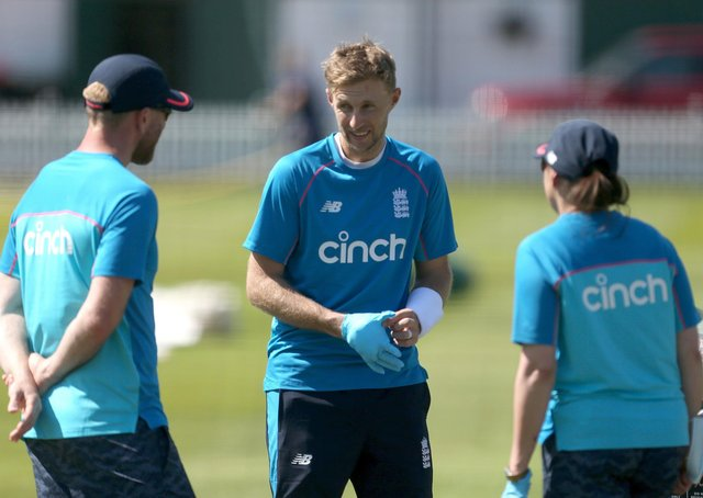 Anxious moment: Yorkshire's England Test captain Joe Root is treated after being struck on the hand in the nets, but should be fit to face New Zealand. Picture: Steven Paston/PA