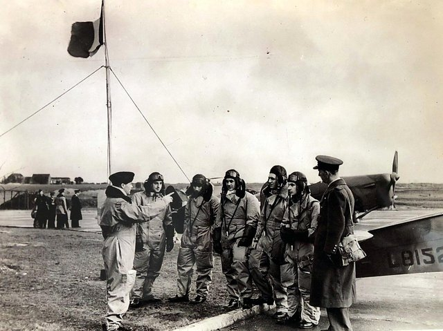 Yves Mahé with French airmen retraining for RAF aircraft. (Image copyright of Loïc Mahé, shared with the AFHG)