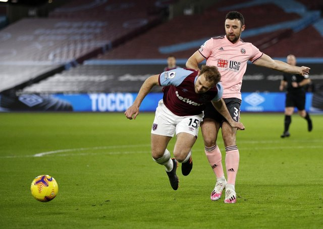 No penalty: VAR ruled out a penalty call for Sheffield United's Enda Stevens's challenge on West Ham United's Craig Dawson.
