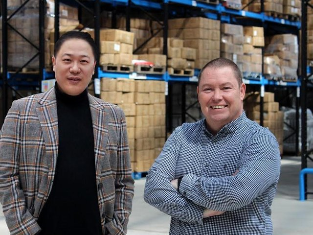 Trading places: (Left to right) Ivan Zhou and Martin Doyle at textiles firm, Pegasus World
