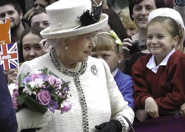 The Queen is greeted by flag-waving well-wishers as she visits the City Varieties Music Hall in Leeds on July 19, 2012 during her diamond jubilee tour.