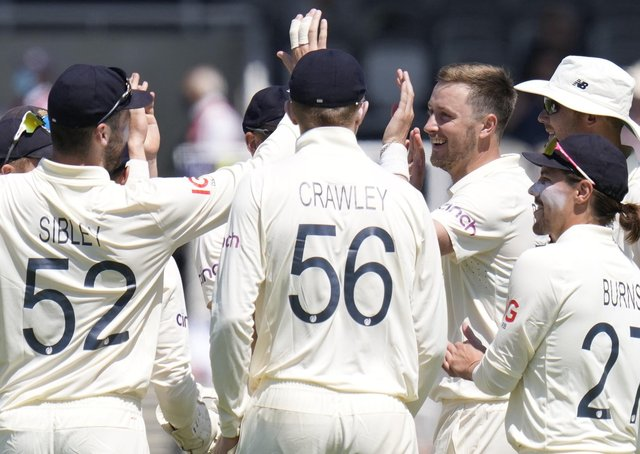 Wicket: England's Ollie Robinson celebrates taking the wicket of New Zealand's Colin de Grandhomme. Picture: AP Photo/Kirsty Wigglesworth