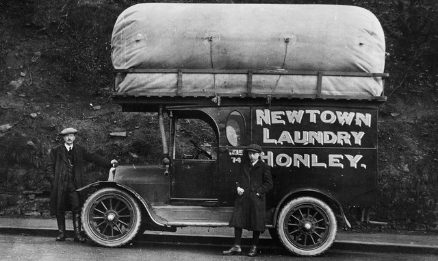 circa 1925:  A mobile laundrette operating in Newtown, Honley, provides a shirt and collar dressing service as well as dyeing and dry-cleaning for West Riding and Yorkshire.  (Photo by Chaloner Woods/Getty Images)