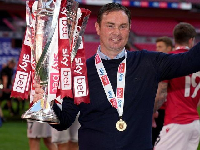 Last act?: Morecambe manager Derek Adams celebrates with the trophy after the Sky Bet League Two play-off final - but has been linked with the vacancy at Bradford City. Picture: John Walton/PA Wire.