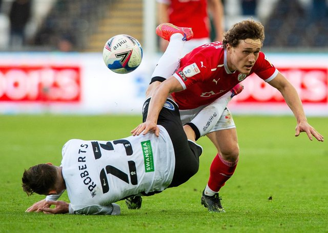 Fall guy: Bit of a tangle for Connor Roberts and Callum Styles at the Liberty Stadium.Picture: Bruce Rollinson