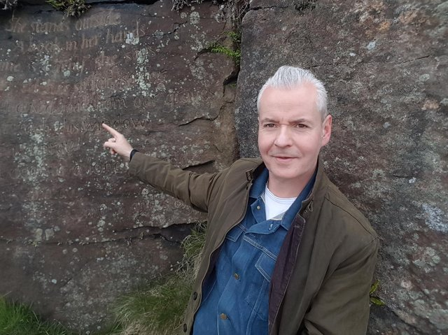 Michael Stewart at the Emily Stone, part of the Brontë Stones project; the poem is written by Kate Bush.