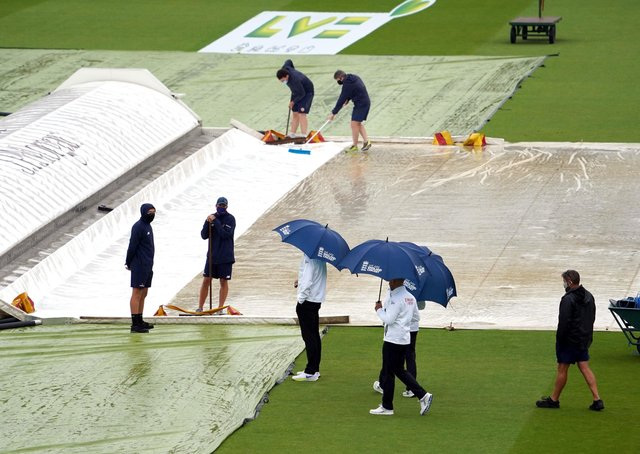 Umpires inspect the pitch as play continues to be delayed due to rain during day three of the first Test match at Lord's. Picture: Adam Davy/PA