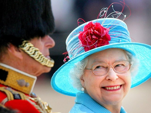Queen Elizabeth II smiling with the Duke of Edinburgh during the annual Trooping the Colour parade in 2009. This year's Trooping the Colour is taking place two days after what would have been the Duke's 100th birthday.