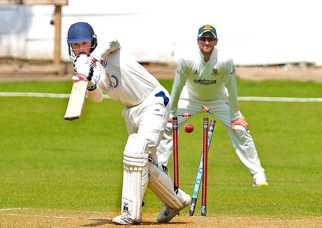 Unlucky 13: Batley opener Abdul Wahid is bowled by Sam Lodge for 13. New Farnley won the Bradford League game by nine wickets. Picture: Steve Riding