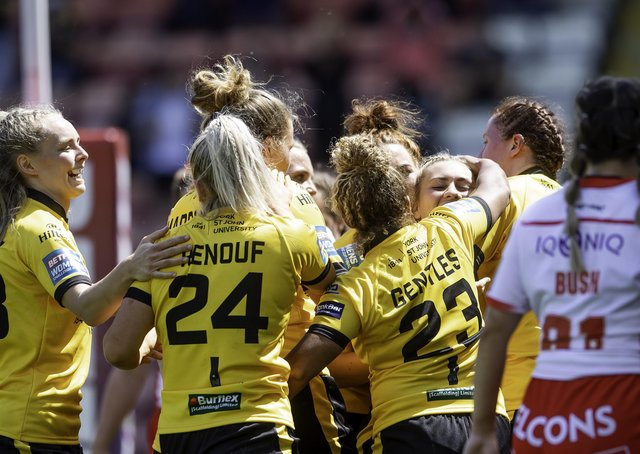 Well done: York's Sinead Peach is congratulated on her try against St Helens.