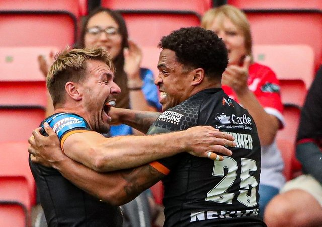 Hat-trick star: Castleford's Jordan Turner is congratulated on one of his tries by Michael Shenton. Pictures: SWPix