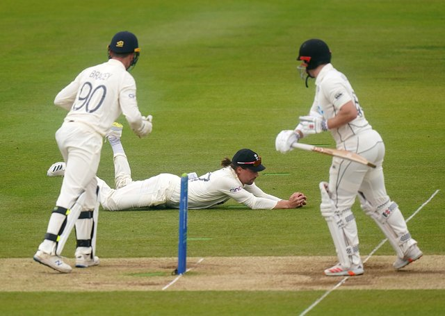 Out: New Zealand's Henry Nicholls, right is caught by England's Rory Burns off the bowling of Joe Root.